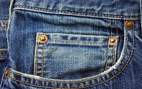 close up photo of blue denim bottoms pocket