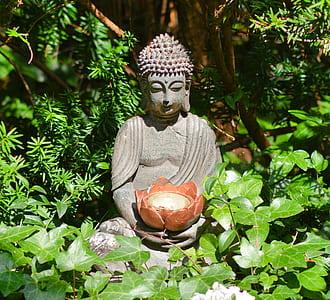 Dyanara Mudra statuette on garden
