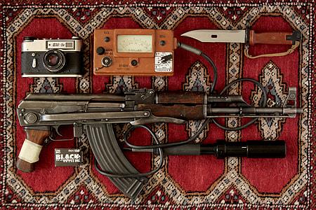 brown AK-47 rifle