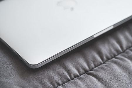 Closed Macbook Laptop on a Sofa #2