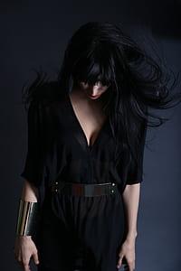 women wearing black dress