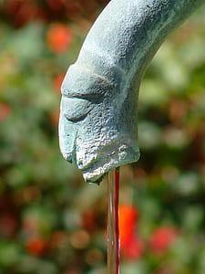 concrete fountain nozzle in closeup photography