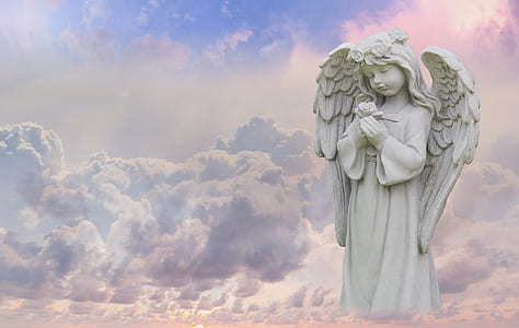 white angel statue with white clouds