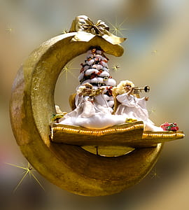 angel playing trumpet in crescent moon ornament