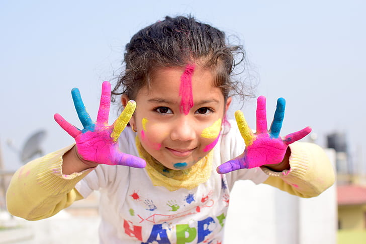 Royalty-Free photo: Girl with paint on hands | PickPik
