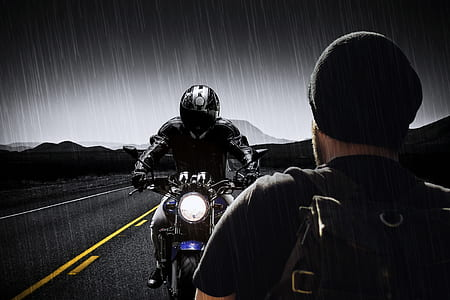 rider in black and gray full-face motorcycle helmet riding black and blue naked motorcycle