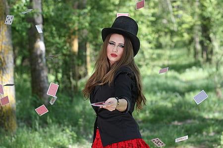 woman in black blazer doing card magic