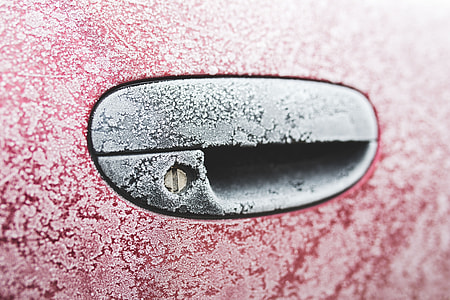 Frost on a red car