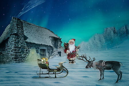 Santa Claus with house on snow with aurora