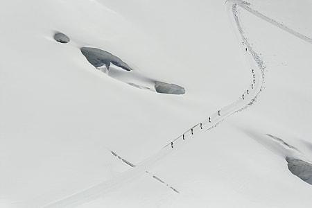 people walking on snow during daytime