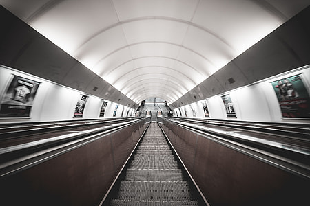 Symmetric Public Transport Network Underground Escalator
