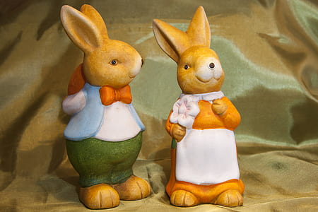 boy and white rabbit figurines