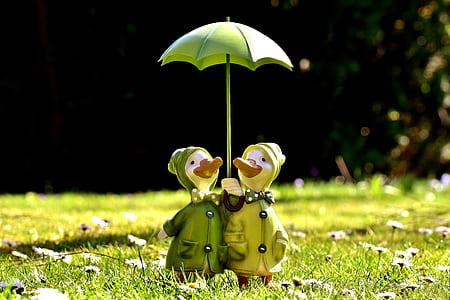 two ducks under green umbrella patio decor
