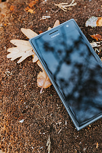 Black mobile phone on the ground