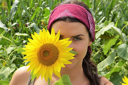female holding sunflower