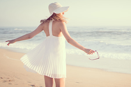 Woman wearing hat and summer dress