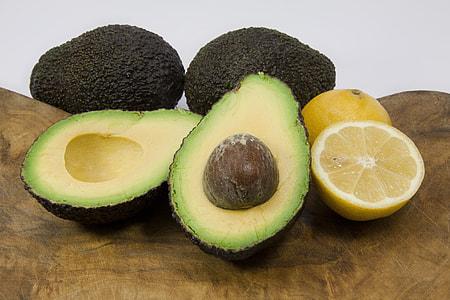 sliced avocado beside sliced yellow citrus