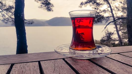 Turkish clear glass teacup on selective focus photograph
