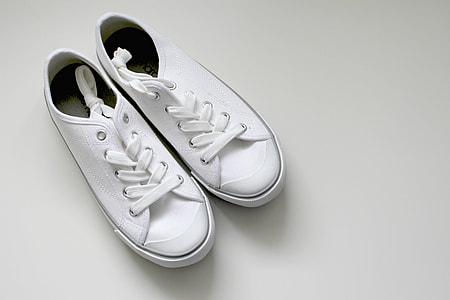 pair of white low-top sneakers