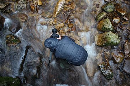 Camera man on water stream