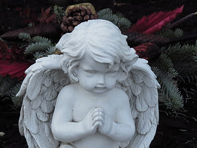 white cherub statue