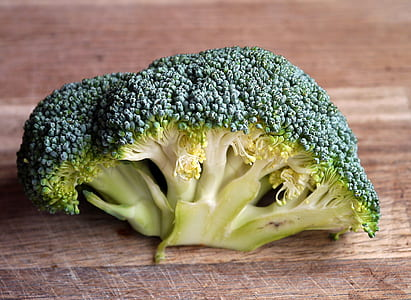 Green Broccoli Vegetable on Brown Wooden Table