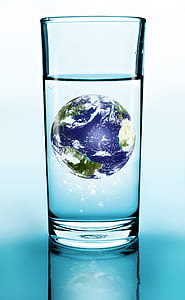 clear drinking glass with globe inside illustration