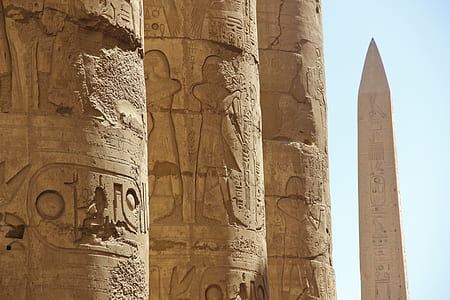 photo of brown pillars with hieroglyphs