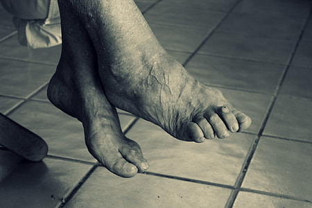 grayscale photography of feet