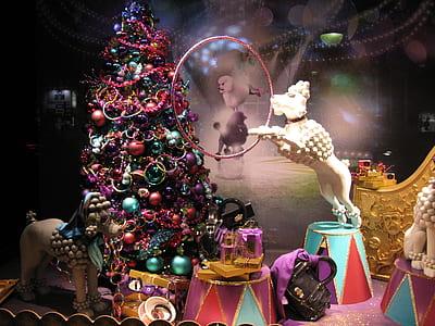 white dog figurine beside christmas tree inside the room