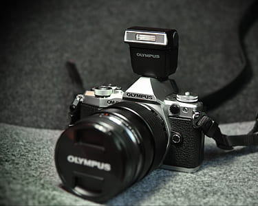 grayscale photo of Olympus camera