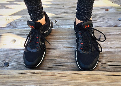 person wearing Under Armour running shoes