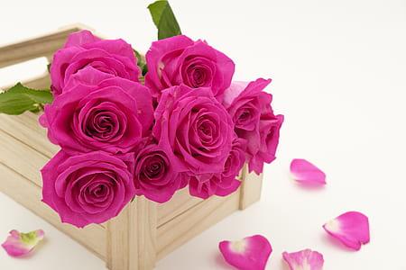 pink rose flowers on brown wooden organizer