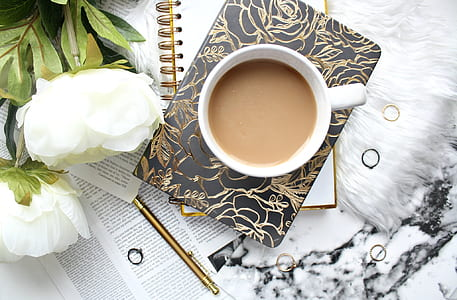 coffee near white peonies