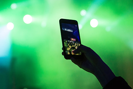 Using mobile smartphone at music festival