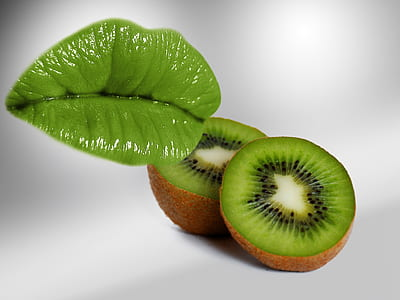 two kiwi fruits on top of white surface