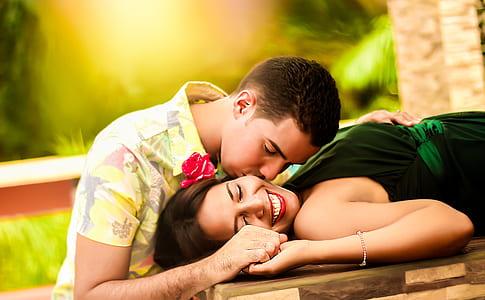 man kissing woman photo