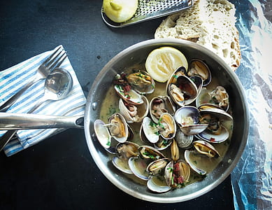 cooked seashells on gray stainless steel cooking ware