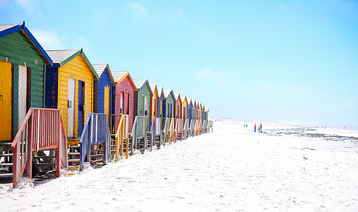 blue, yellow, green Bunk houses beside seashore during day time