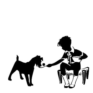 boy holding bowl and sitting on chair with dog logo