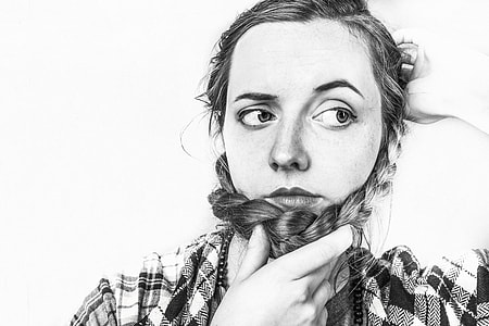 woman in black and white shirt in grayscale photo