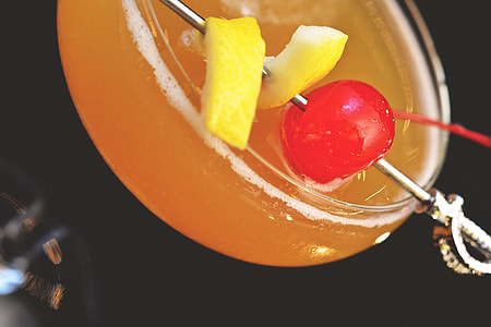 Closeup shot of a cocktail and cherry drink