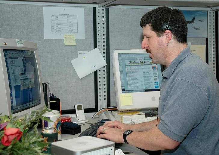 man in front of desktop computer