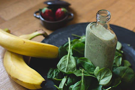 Homemade green smoothie with ingredients