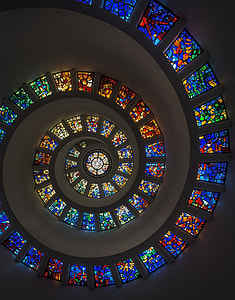 bottom-view of spiral ceiling with stain glass windows