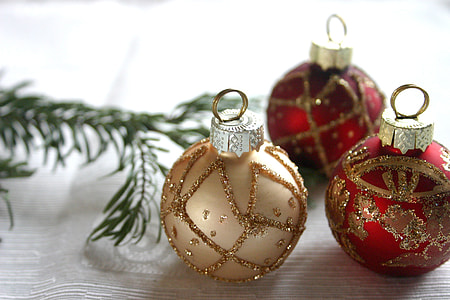 three Christmas baubles in tilt shift photography
