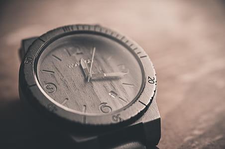 selective focus photo of black analog watch