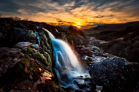 waterfalls under golden hour