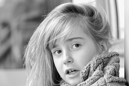grayscale photo of girl wearing knitted apparel