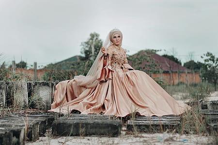 women's beige silk long-sleeved wedding dress with veil